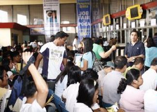 filipinos looking for jobs abroad at a poea job fair photo credit poea